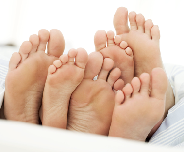 three pairs of bare feet