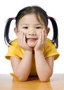smiling preschool girl with pigtails