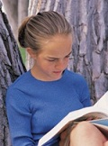 girl studying the dictionary for spelling bee prep