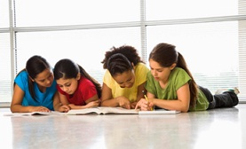 group of girls studying spelling word lists together