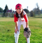 girl playing baseball in the outfield