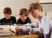 boys studying spelling bee words
