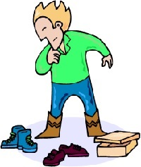 Boy trying on lots of shoes, part of our 5th grade worksheet called,