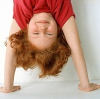 first grader standing on hands, upside down