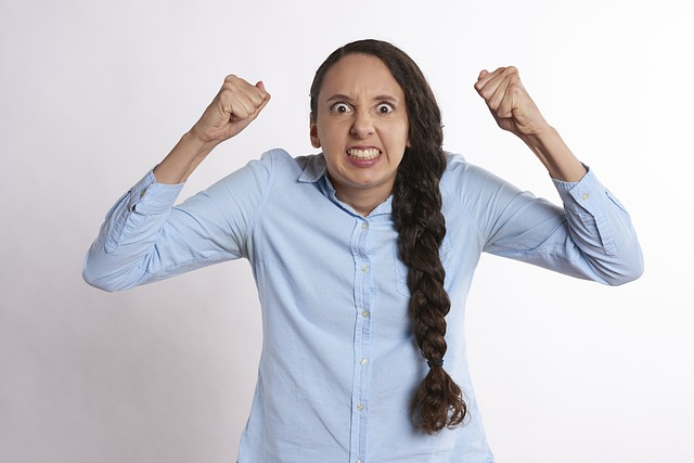 Frustrated young woman, shaking her fists