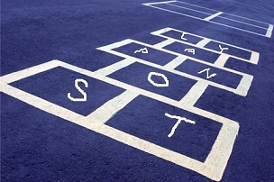 hopscotch board with letters written inside the spaces