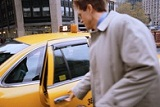man getting into a taxi