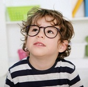 prechool boy wearing big glasses