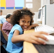 young girl working at computer