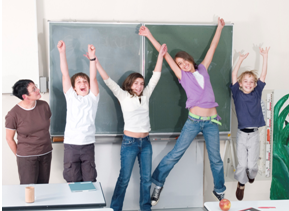 students jumping in front of a chalkboard