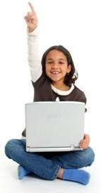 third grade girl with laptop, raising her hand