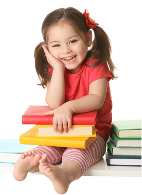 smiling young girl sitting on a stack of books